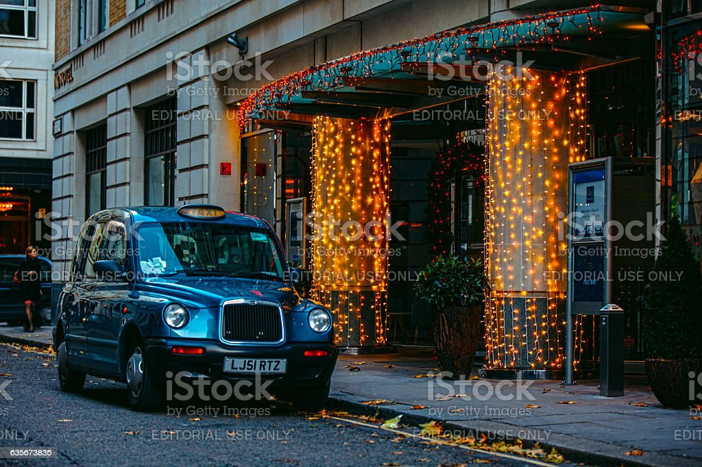 London taxicab parked at evening street stock photo