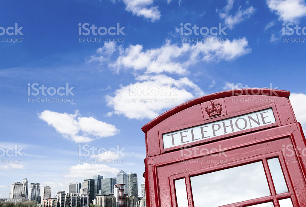London telephone booth on canary wharf skyline royalty-free stock photo