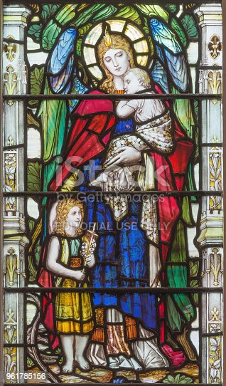 istock London - The angel with the child Jesus and little St. John the Baptist on the stained glass 961785156