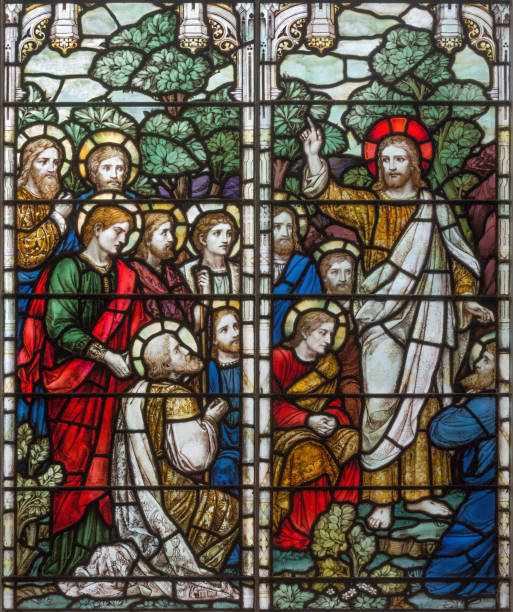 London - The Apparition of resurrected Jesus to apostle on the stained glass in church Holy Trinity Brompton. stock photo