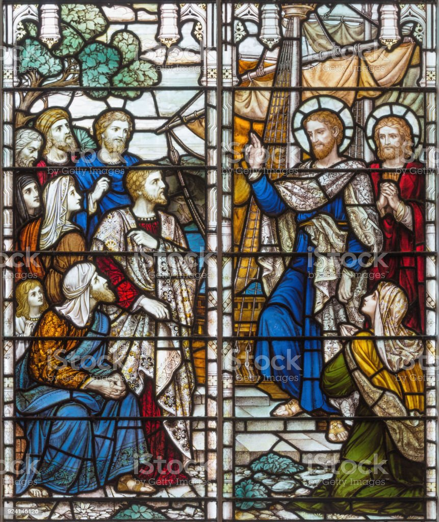 London -  The benediction of St. Paul the Apostle before shiping on the stained glass in church Holy Trinity Brompton. stock photo
