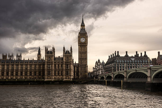 London - The Houses of Parliament and the Big Ben London - The Houses of Parliament and the Big Ben under thick dark clouds. city of westminster london stock pictures, royalty-free photos & images
