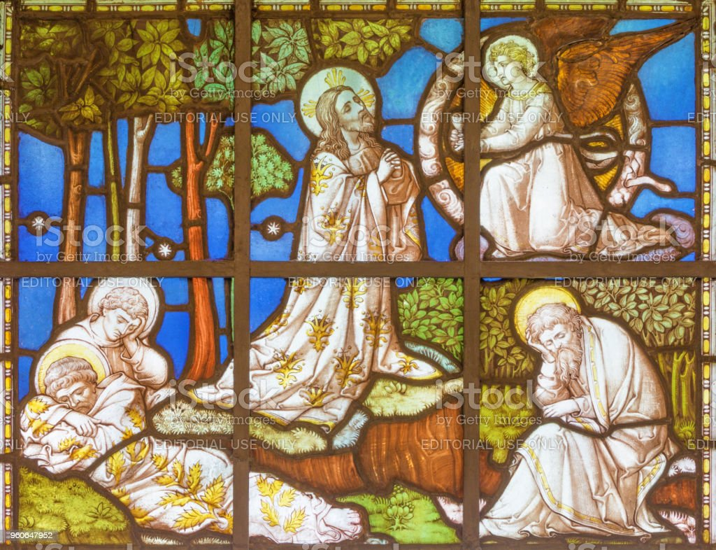 London - The Jesus Prayer in Gethsemane garden on the stained glass stock photo