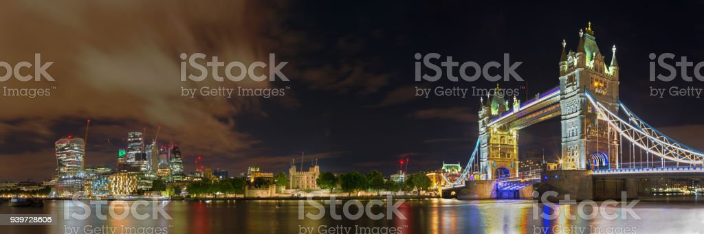 London - The nightly panorama with the Tower bridge, Tower and skyscrapers of financial discrict. stock photo