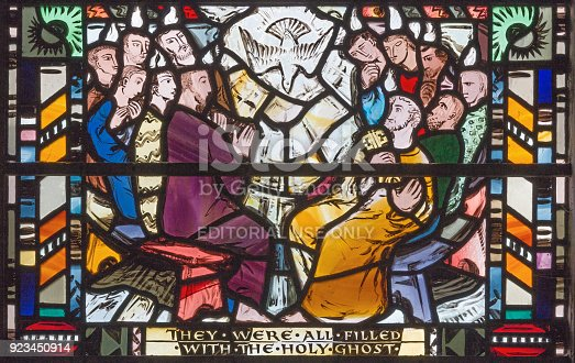istock London - The scene of Pentecost on the stained glass in church St Etheldreda by Charles Blakeman (1953 - 1953). 923450914