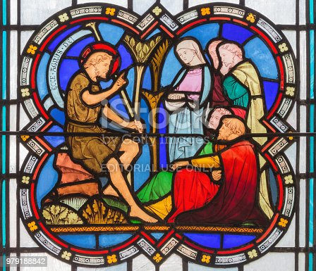 istock London - The Sermon of St. John the Baptist on stained glass in church St. Michael Cornhill by Clayton and Bell from 19. cent. 979188842