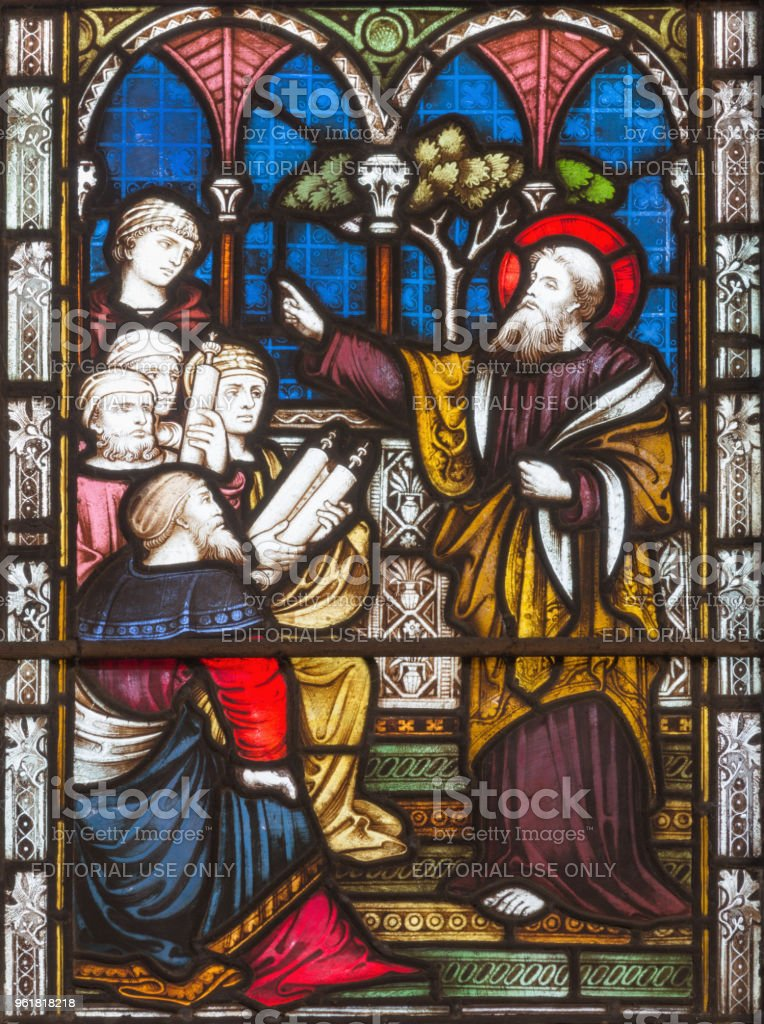 London - The sermon of St. Paul in synagogue  on the stained glass stock photo