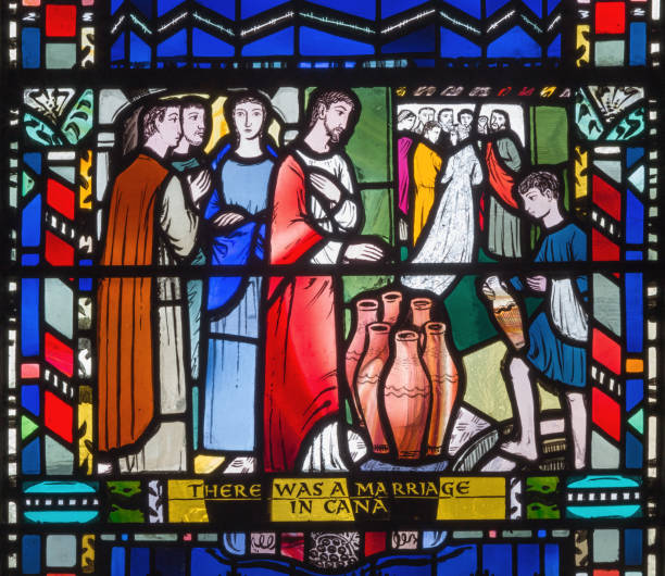 London - The stained glass of he Wedding at Cana in church St Etheldreda by Charles Blakeman (1953 - 1953). stock photo