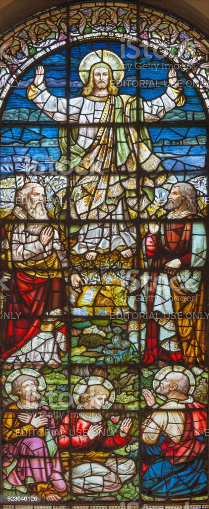 London - The stained glass of Transfiguration in church St. Giles in the Fields from 19. cent. stock photo