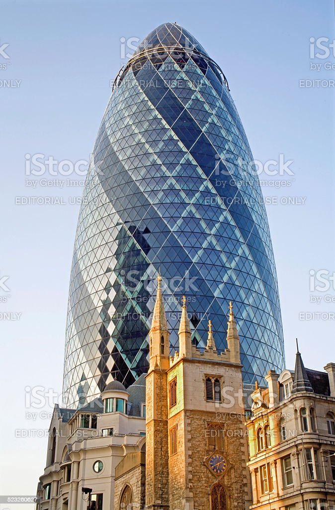 London - The Swiss re tower and neo-gothic houses stock photo