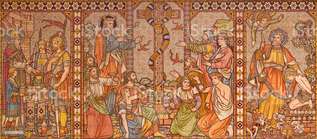 London - The tiled mosaic of Old testament scenes with the patriarchs, Melchizedek, Moses and Abraham in church All Saints by Matthew Digby Wyatt (1820 - 1877). stock photo
