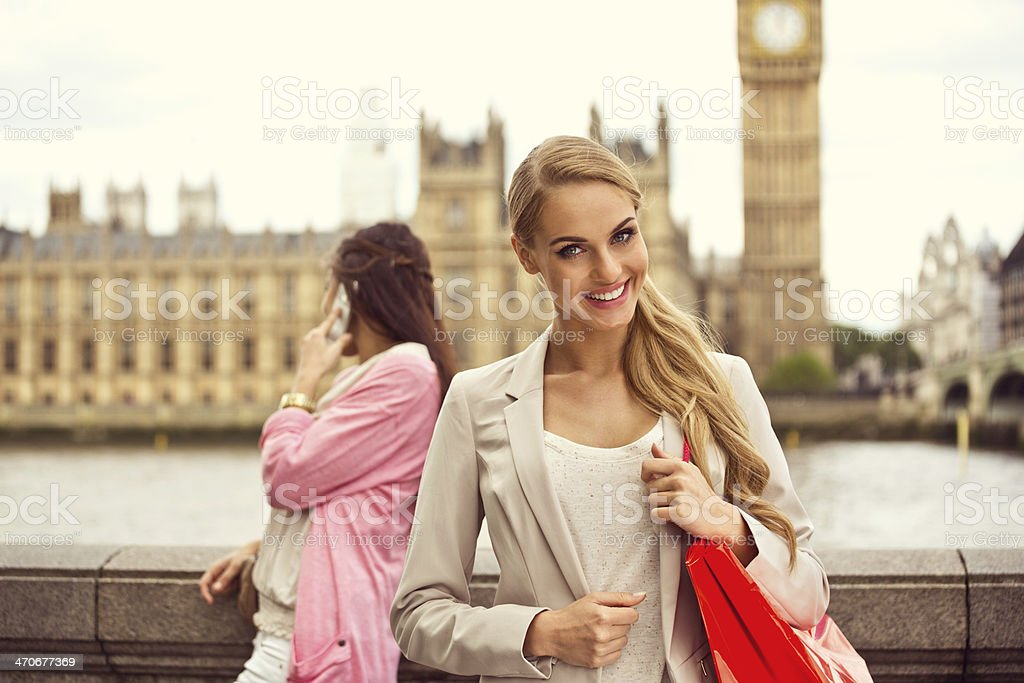 London tourist Outdoor portrait of happy young woman smiling at camera with Houses of Parliament and Big Ben in the background. 20-24 Years Stock Photo