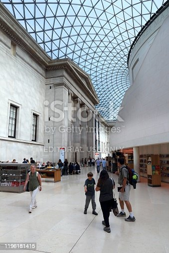People visit British Museum Great Court in London. The museum was established in 1753 and holds approximately 8 million objects.
