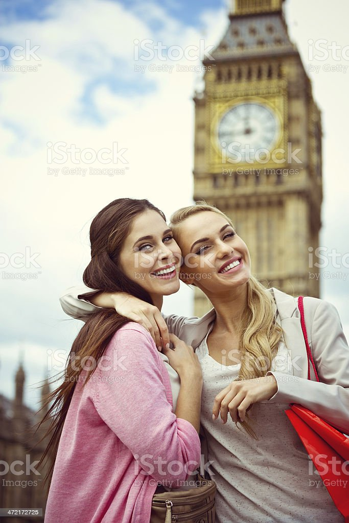 London tourists Outdoor portrait of two happy young women smiling at the camera with Big Ben in the background. 20-24 Years Stock Photo