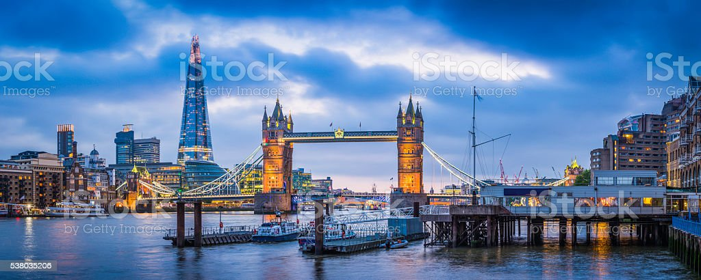 London Tower Bridge and The Shard illuminated over Thames panorama stock photo