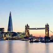 London's skyline with Tower Bridge, The Shard and City Hall at dusk.