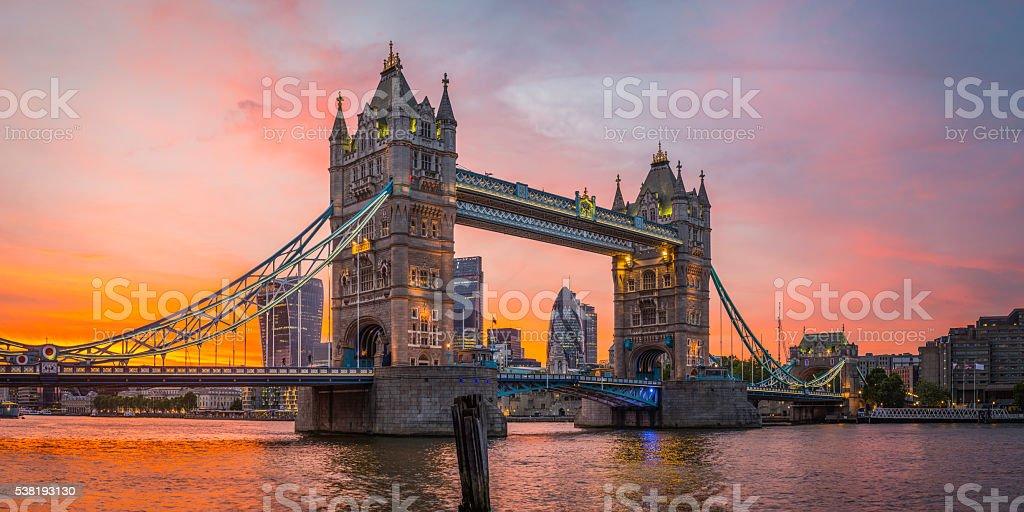 London Tower Bridge City skyscrapers illuminated Thames golden sunset UK stock photo