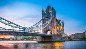 London Tower Bridge illuminated at sunset over River Thames panorama