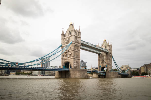 London Tower Bridge on Thames river Tower Bridge in London on Thames River on autumn  day bascule bridge stock pictures, royalty-free photos & images