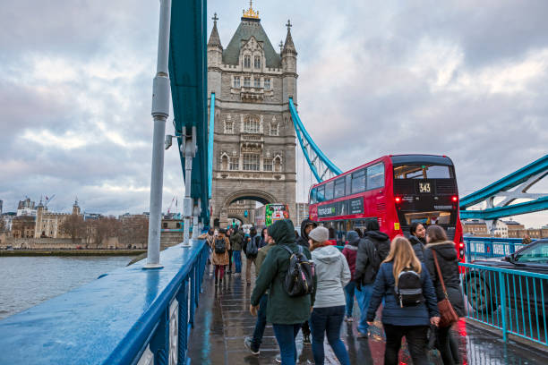 London Tower Bridge London, UK - Dec 11, 2019: Commuters crossing Tower Bridge during rush hour. Tower Bridge links the South of River Thames to the City area. central london stock pictures, royalty-free photos & images