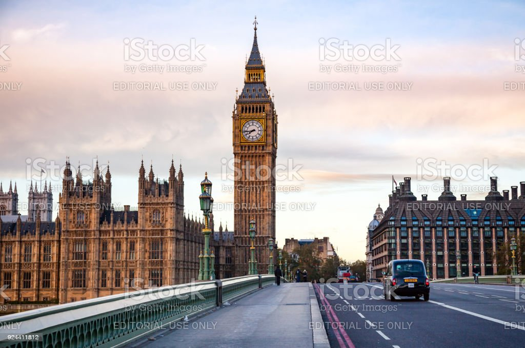 London traffic scene with Taxicab moves along the Westminster Bridge stock photo