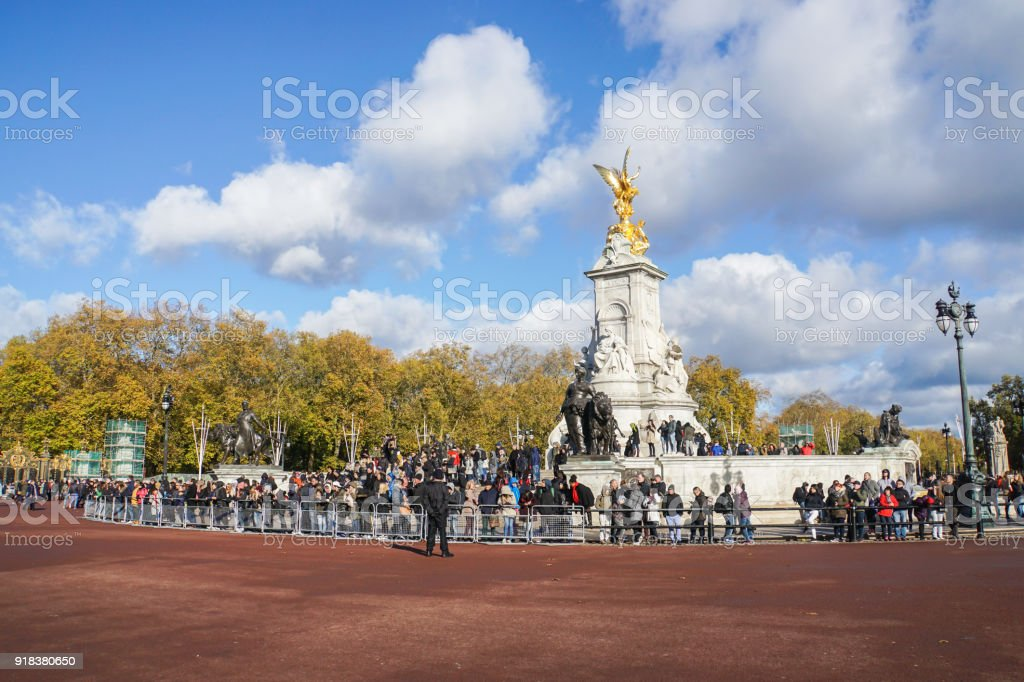 London / UK - November 14 2017: group of people gather at Victoria Memorial statue at Buckingham Palace stock photo