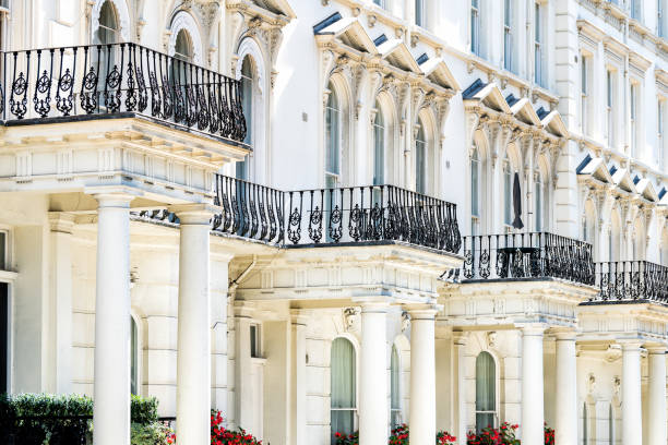 London, UK Street road Chelsea Kensington with terraced housing balconies buildings and columns in old vintage historic traditional style flats stock photo