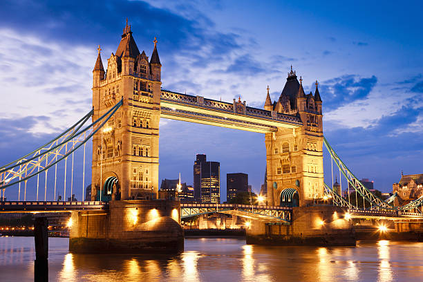 London UK Tower Bridge at River Thames Sunset Twilight Scene Tower Bridge in London, UK, at the beginning of night, brightly illuminated with reflections on the River Thames.  tower bridge stock pictures, royalty-free photos & images