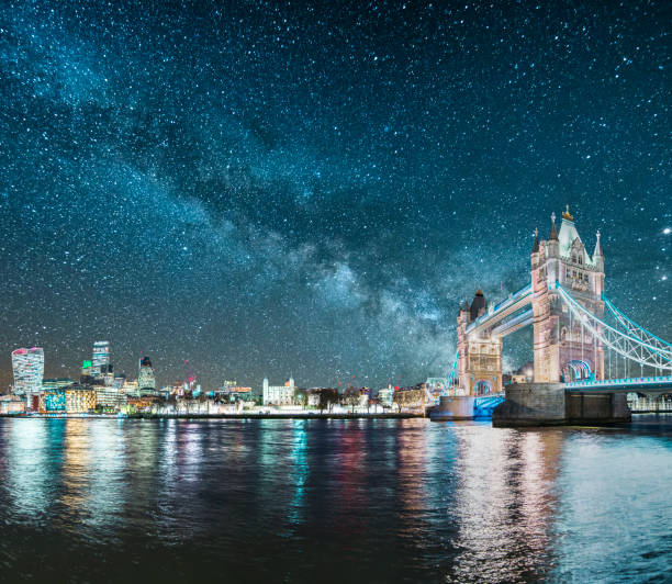 London under the stars A beautiful image featuring London, England (Tower bridge and skyscrapers) under the Milky Way. tower bridge stock pictures, royalty-free photos & images