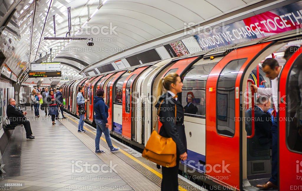 London underground London, UK - April 22, 2015: People waiting at underground tube platform for train arrives 2015 Stock Photo