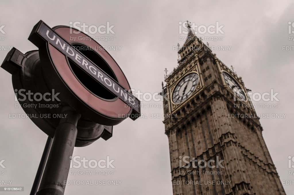 London Underground Sign + Big Ben stock photo