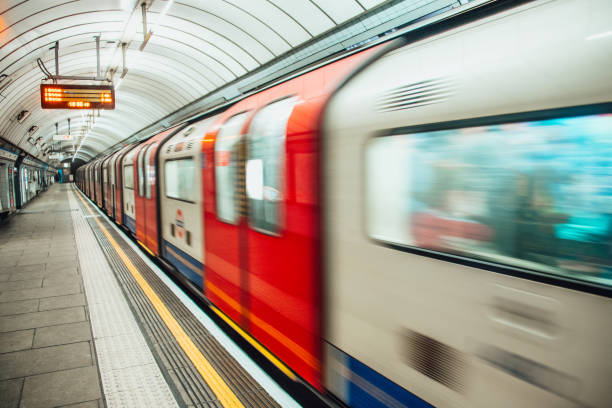london underground train in motion - tube stock pictures, royalty-free photos & images