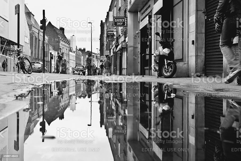 London Urban Scene, People Reflection on a Puddle stock photo