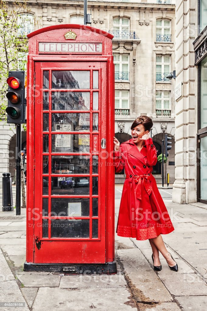 London Woman in Red Trench Coat stock photo