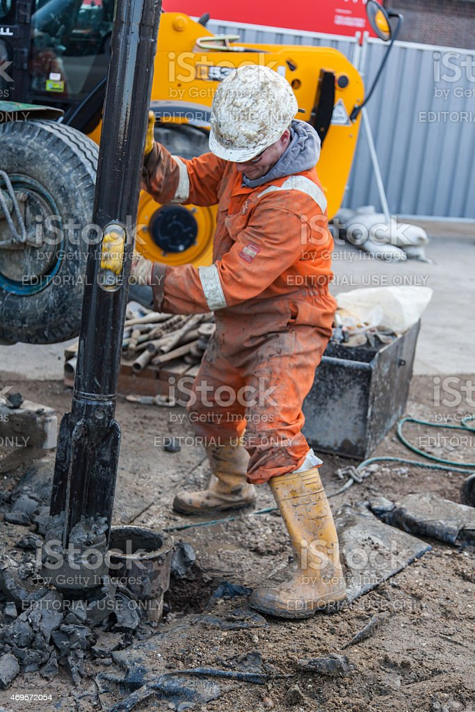 London Workman a drilling a borehole stock photo