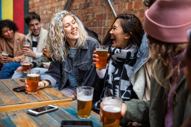 Londoners group of friends meet up in a pub stock photo