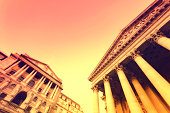 Low angle view of the main facades of The Bank of England and London Stock Exchange in the City of London.