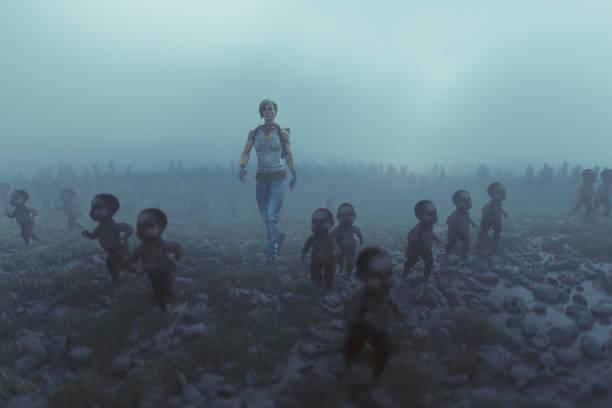 lone apocalypse survivor with walking dead zombie children - zombie apocalypse stock photos and pictures