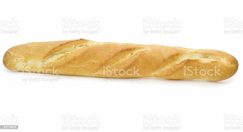 A lone baguette of French bread on a white background royalty-free stock photo