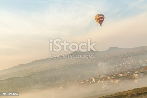 istock lone balloon over a  society in the mist 531359657