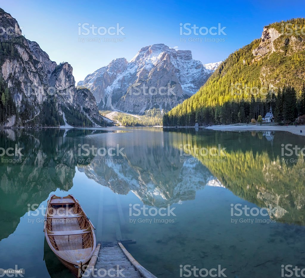 Lone Boat at Sunrise at UNESCO World Heritage Lake Braies stock photo
