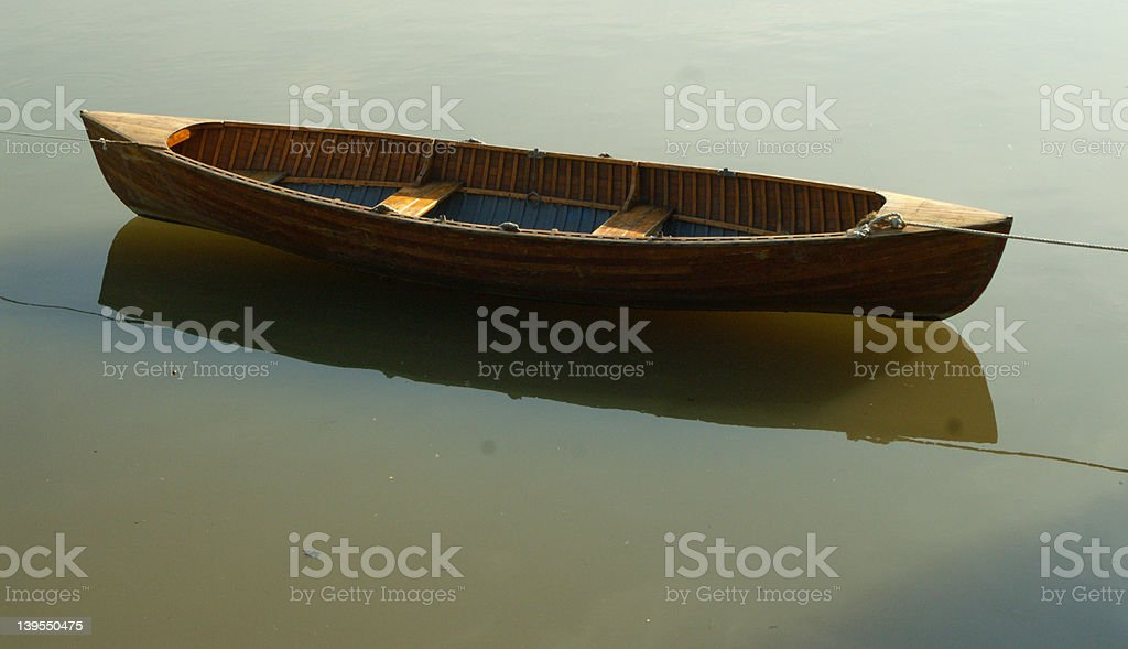 Lone boat in muddy water royalty-free stock photo