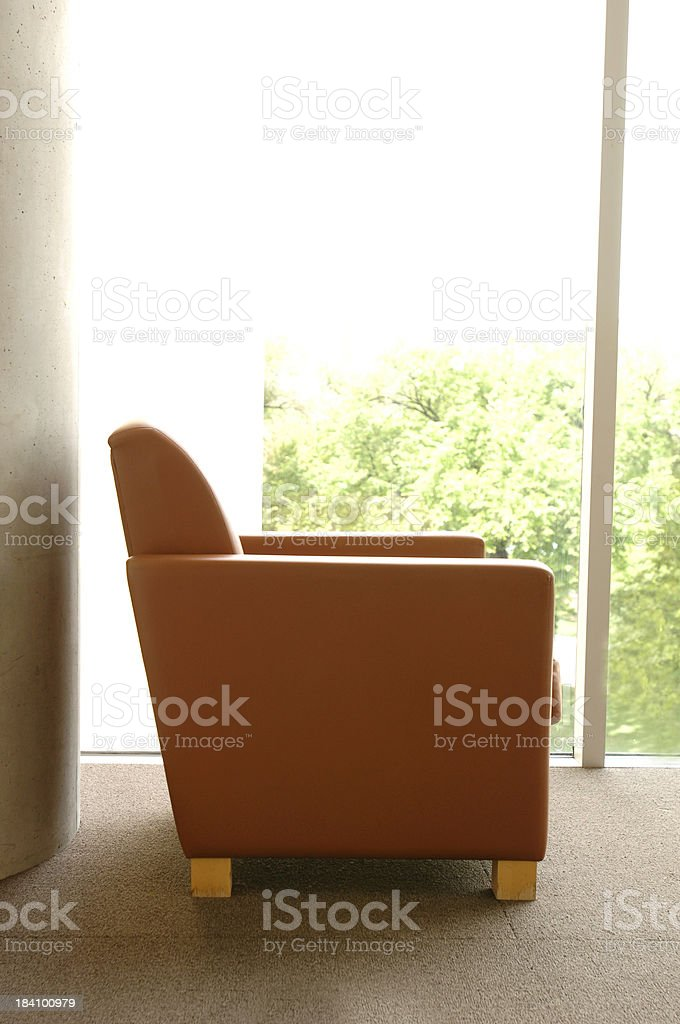 Lone Chair Against Large Window royalty-free stock photo