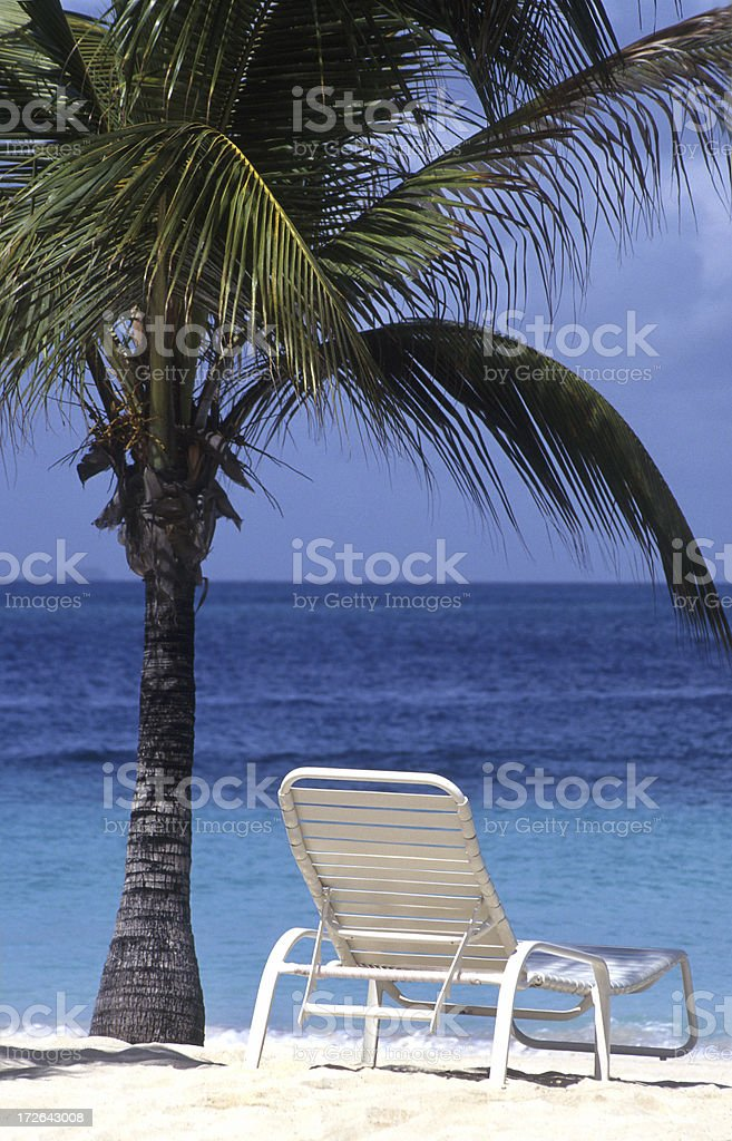 Lone chair on Caribbean beach royalty-free stock photo