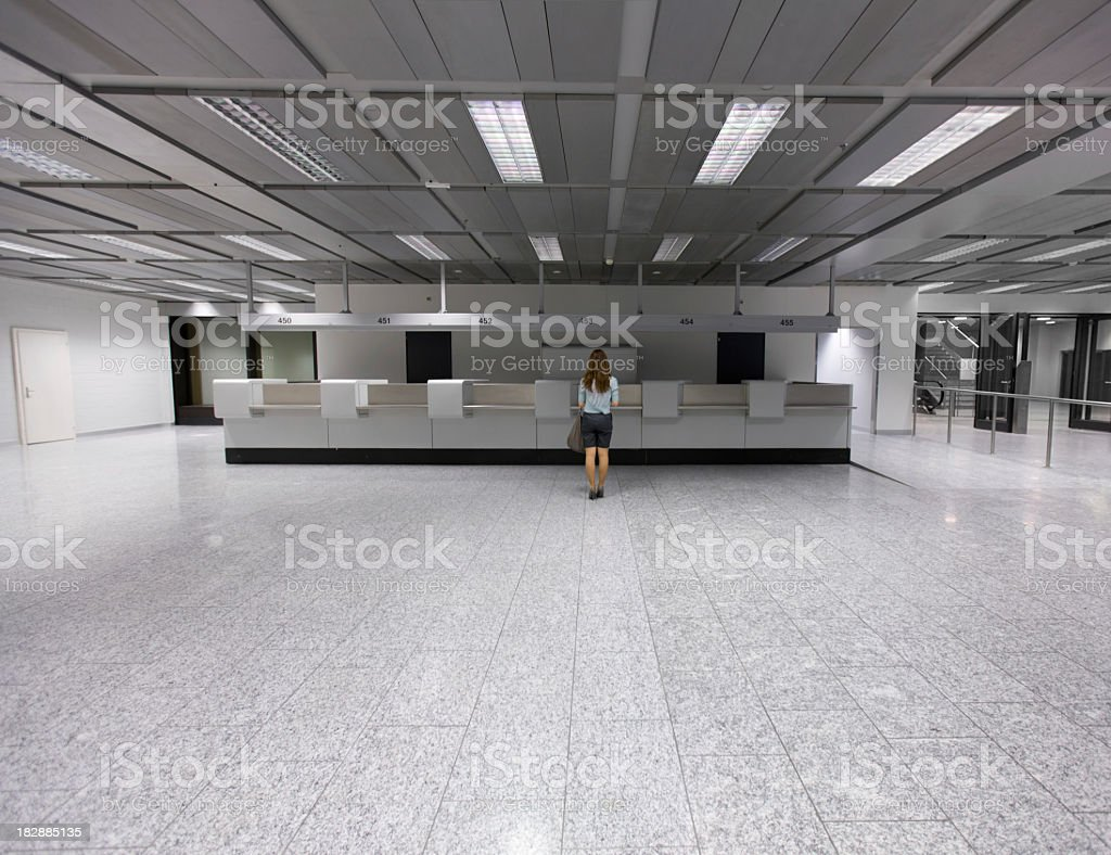 Lone customer in a large empty terminal stock photo