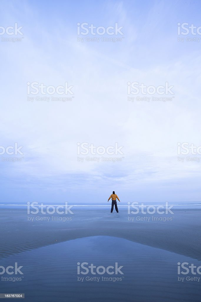 Lone figure on an empty beach royalty-free stock photo