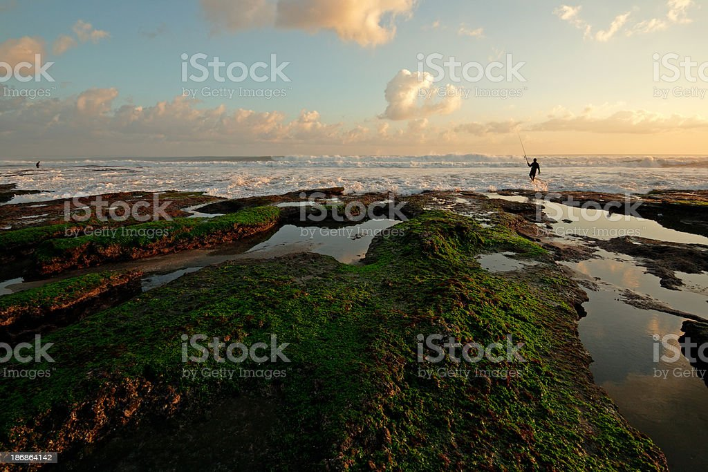 Lone fisherman at Tanah Lot royalty-free stock photo