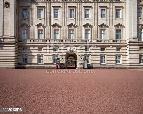 4th May, 2019 - Lone Guardsman picked out in bright red against the expanse of  the Buckingham Palace architecture