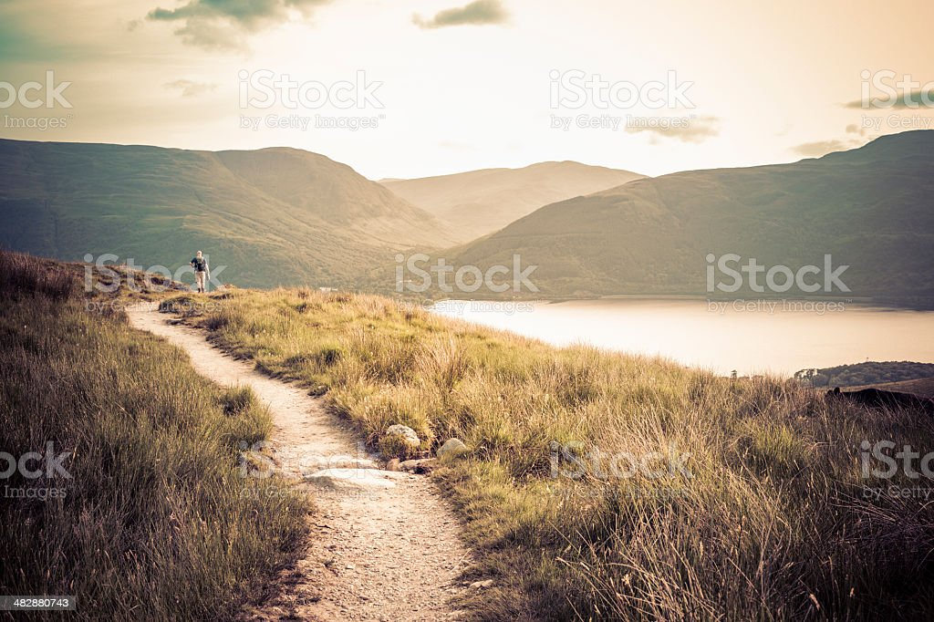 Lone hiker walking on Ben Lomond mountain stock photo