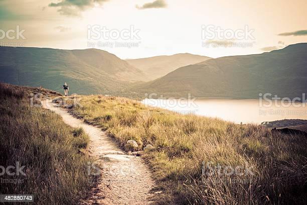 Photo of Lone hiker walking on Ben Lomond mountain